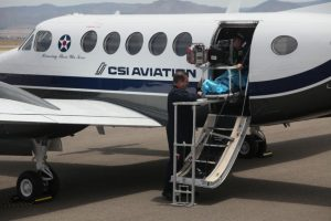 Medical flight personnel assist a patient on CSI Aviation's Beachcraft 300 plane at the Albuquerque International Sunport, where the aviation company is headquartered. Photo: Courtesy of CSI Aviation krobinson-avila@abqjournal.com Thu Jul 14 15:55:23 -0600 2016 1468533311 FILENAME: 215268.jpg